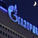 epa01589337 The logo of Russian gas company Gazprom illuminated on Gazprom headquarters in Moscow, Russia, 02 January 2009. Gazprom has totally cut gas deliveries to Ukraine from 10 AM Moscow time 01 January 2009. Russia has proposed holding special hearings at the European Parliament regarding the transit of Russian natural gas to Western Europe through Ukraine.  EPA/SERGEI ILNITSKY